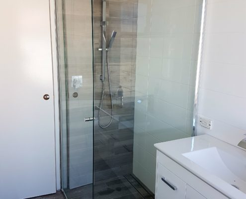 Semi-frameless shower screen Perth - Exclusive Wall Design